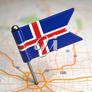 Small Flag of Iceland Sticked in the Map Background with Selective Focus.