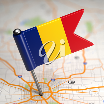 Small Flag of Romania Sticked in the Map Background with Selective Focus.