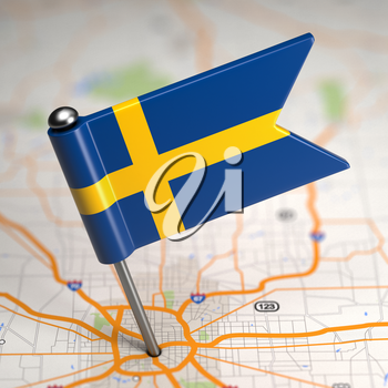 Small Flag of Kingdom of Sweden on a Map Background with Selective Focus.