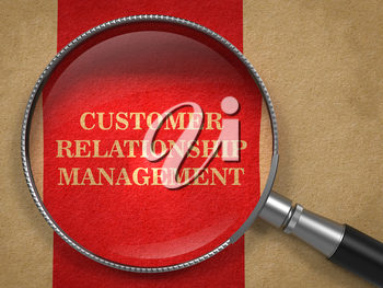 CRM - Customer Relationship Management Concept. Magnifying Glass on Old Paper with Red Vertical Line Background.