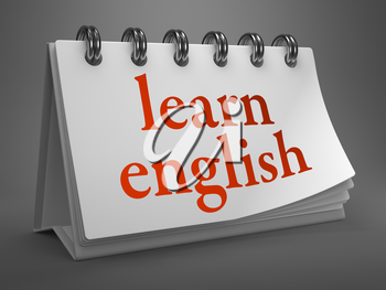 Learn English - Red Words on White Desktop Calendar Isolated on Gray Background.