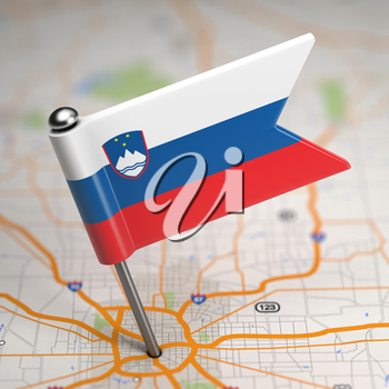 Small Flag of Slovenia on a Map Background with Selective Focus.