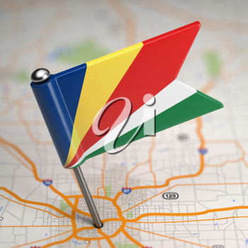 Small Flag of Seychelles on a Map Background with Selective Focus.