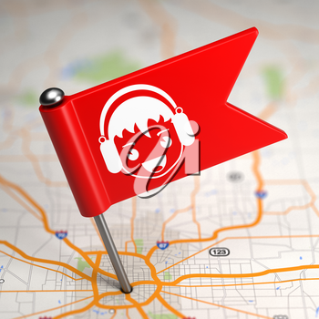 Red Small Flag with Boy with Headphones on a Map Background with Selective Focus.