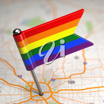 Small Flag of Gay on a Map Background with Selective Focus.