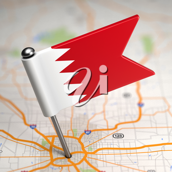 Small Flag of Bahrain on a Map Background with Selective Focus.
