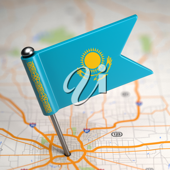 Small Flag of Kazakhstan on a Map Background with Selective Focus.