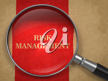 Risk Management Concept. Magnifying Glass on Old Paper with Red Vertical Line Background.