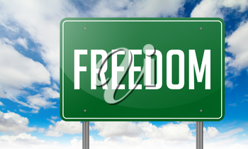 Highway Signpost with Freedom wording on Sky Background,