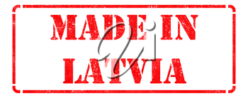 Made in Latvia inscription on Red Rubber Stamp Isolated on White.