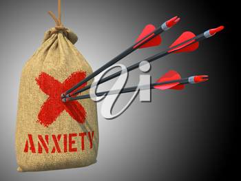 Anxiety - Three Arrows Hit in Red Mark Target on a Hanging Sack on Grey Background.