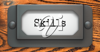 Skills - Inscription on File Drawer Label on a Wooden Background.