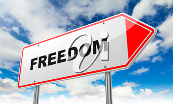 Freedom- Inscription on Red Road Sign on Sky Background.
