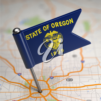 Small Flag of Oregon on a Map Background with Selective Focus.