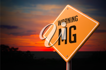 MG on Warning Road Sign on Sunset Sky Background.