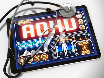 ADHD - Diagnosis on the Display of Medical Tablet and a Black Stethoscope on White Background.