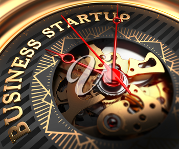 Business Startup on Black-Golden Watch Face with Closeup View of Watch Mechanism.