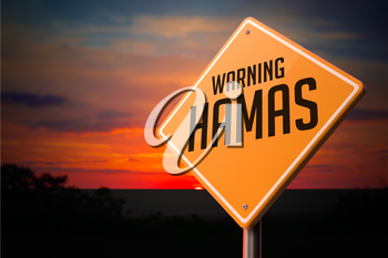 Hamas on Warning Road Sign on Sunset Sky Background.