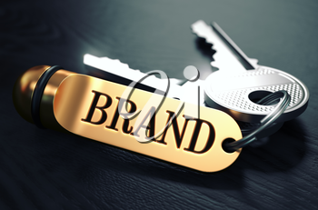 Brand - Bunch of Keys with Text on Golden Keychain. Black Wooden Background. Closeup View with Selective Focus. 3D Illustration. Toned Image.