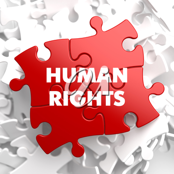 Human Rights on Red Puzzle on White Background.