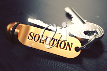 Keys to Solution - Concept on Golden Keychain over Black Wooden Background. Closeup View, Selective Focus, 3D Render. Toned Image.