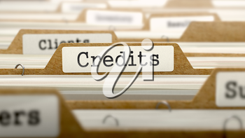 Credits Concept. Word on Folder Register of Card Index. Selective Focus.