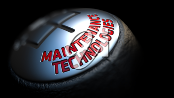 Maintenance Technologies - Red Text on Car's Shift Knob on Black Background. Close Up View. Selective Focus.