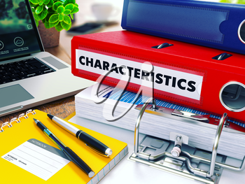 Characteristics - Red Ring Binder on Office Desktop with Office Supplies and Modern Laptop. Business Concept on Blurred Background. Toned Illustration.