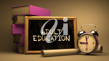 Handwritten Adult Education on a Chalkboard. Composition with Chalkboard and Stack of Books, Alarm Clock and Rolls of Paper on Blurred Background. Toned Image.