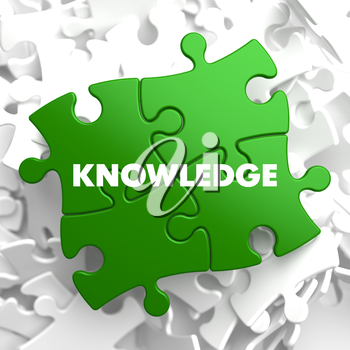 Knowledge on Green Puzzle on White Background.