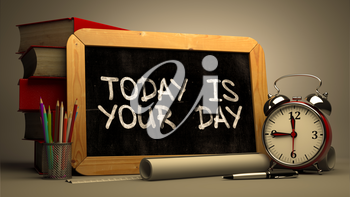Motivational Quote - Today is Your Day - Handwritten on Chalkboard. Time Concept. Composition with Chalkboard and Stack of Books, Alarm Clock and Scrolls on Blurred Background. Toned Image.