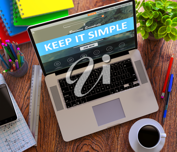 Keep It Simple Concept. Modern Laptop and Different Office Supply on Wooden Desktop background.
