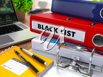 Red Ring Binder with Inscription Black List on Background of Working Table with Office Supplies, Laptop, Reports. Toned Illustration. Business Concept on Blurred Background.