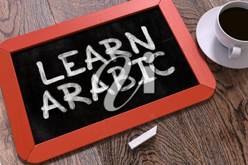 Learn Arabic Concept Hand Drawn on Red Chalkboard on Wooden Table. Business Background. Top View.