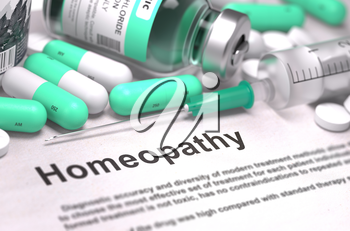Homeopathy - Printed Diagnosis with Blurred Text. On Background of Medicaments Composition - Mint Green Pills, Injections and Syringe.