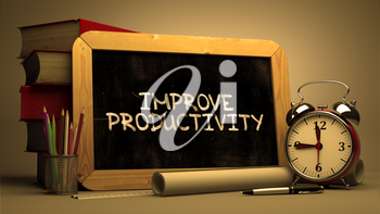 Improve Productivity Handwritten on Chalkboard. Time Concept. Composition with Chalkboard and Stack of Books, Alarm Clock and Scrolls on Blurred Background. Toned Image.
