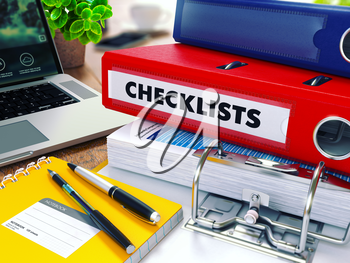 Checklists - Red Ring Binder on Office Desktop with Office Supplies and Modern Laptop. Business Concept on Blurred Background. Toned Illustration.