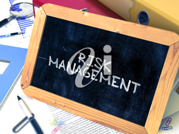 Hand Drawn Risk Management - Business Concept  on Chalkboard. Blurred Background. Toned Image.
