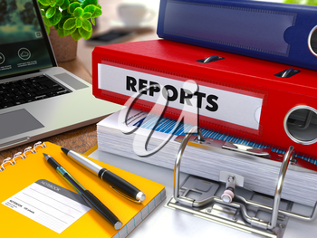 Red Ring Binder with Inscription Reports on Background of Working Table with Office Supplies, Laptop, Reports. Toned Illustration. Business Concept on Blurred Background.