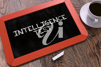 Intelligence Test Concept Hand Drawn on Red Chalkboard on Wooden Table. Business Background. Top View.