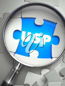 USP - Unique Selling Point - Word on the Place of Missing Puzzle Piece through Magnifier. Selective Focus.