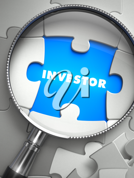 Investor - Word on the Place of Missing Puzzle Piece through Magnifier. Selective Focus.