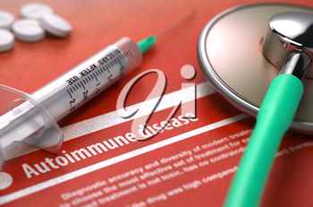 Autoimmune disease - Printed Diagnosis on Orange Background and Medical Composition - Stethoscope, Pills and Syringe. Medical Concept. Blurred Image.