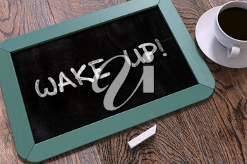 Wake Up - Motivational Quote on Small Blue Chalkboard. Business Background. Top View.