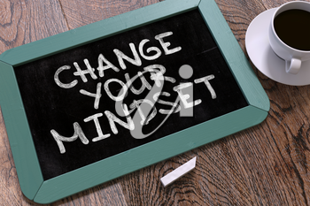 Change Your Mindset. Motivation Quote Hand Drawn on Blue Chalkboard on Wooden Table. Business Background. Top View.