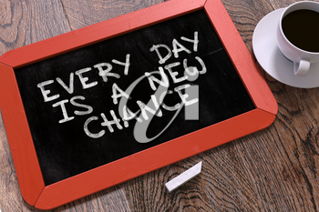 Hand Drawn Motivation Quote - Every Day is a New Chance - on Small Red Chalkboard. Business Background. Top View.