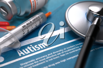 Autism - Printed Diagnosis on Blue Background and Medical Composition - Stethoscope, Pills and Syringe. Medical Concept. Blurred Image.