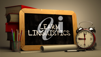 Hand Drawn Learn Linguistics Concept  on Chalkboard. Blurred Background. Toned Image.