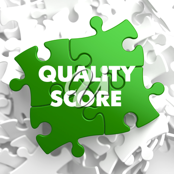 Quality Score on Green Puzzle on White Background.