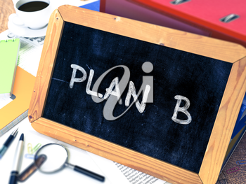 Plan B Handwritten on Chalkboard. Composition with Small Chalkboard on Background of Working Table with Ring Binders, Office Supplies, Reports. Blurred Background. Toned Image.